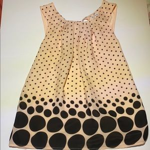 Pink and black polka dotted sleeveless blouse